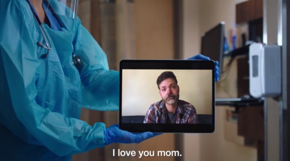 Screenshot of Dept of Health video of son saying goodbye to mom via FaceTime