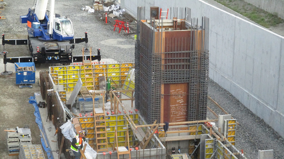 Work progresses on the foundation and elevator shaft for the east head house at 80th Avenue Southeast.