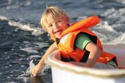 Boy having fun in a small boat.