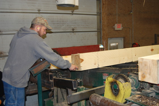 A man working in a woodshop.