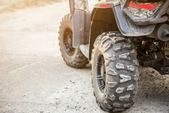 close up of dirty ATV wheel