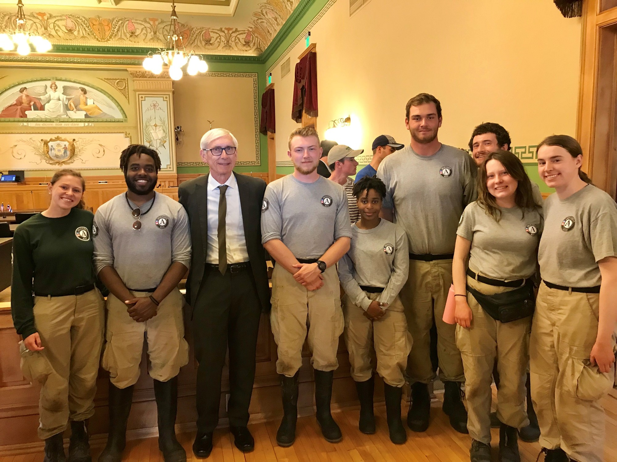 Gov. Evers stands with AmeriCorp members