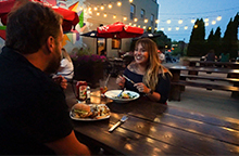 Couple out to eat at an outdoor patio in West Bend