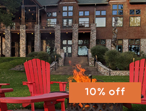 Red chairs around a fire pit at Heartwood Resort in Trego