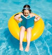 girl reading in pool