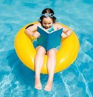 girl reading in pool