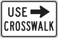 crosswalk sign with arrow
