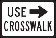 crosswalk sign with arrow