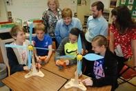 students working on wind turbines
