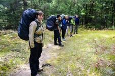 students backpacking in woods