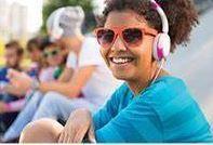 Teen girls with sunglasses wearing headphones