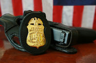 FBI badge and handgun