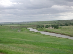 Curve of the Belle Fourche River with bluffs surrounding it