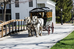 Model T passing a tavern inside Greenfield Village at the Henry Ford