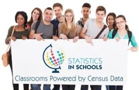 Students holding a sign that reads Statistics in Classrooms