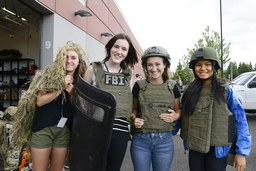 Students wearing riot gear at FBI teen academy