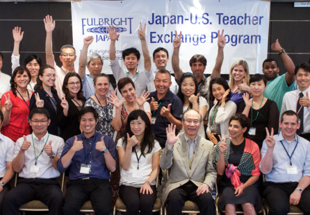 A group of Japan and US teacher posing and waving