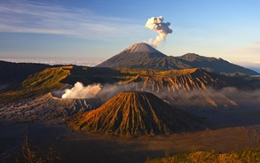 Two volcanos spewing steam in Bromo Tengger Semeru National Park on the island of Jawa, Indonesia