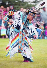 Photo of male Native American dancer in full regalia