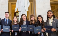 U.S. Senate Youth Program delegates posing in the U.S. Capitol with certificates
