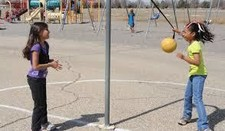 Young girls playing tetherball