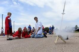 Kids launching a small rocket