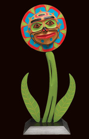 Image of Native flower topped with a traditional sun image and face, typical of the Kwaguilth Tribe