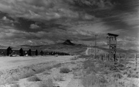 Heart Mountain Japanese American internment camp with Heart Mountain in background and guard tower on the right