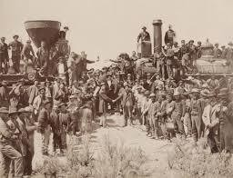 Photo of 1869 ceremony in which the Transcontinental Railroad was completed at Promontory Point, Utah