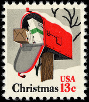 U.S. postage stamp featuring  painting of rural mailbox with door opened to show packages inside and the words Christmas and 13 cents