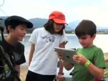 Young students exploring nature with an iPad