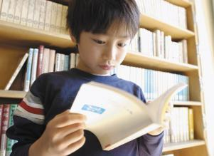 Young Asian boy reading