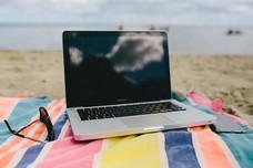 Laptop on blanket on beach