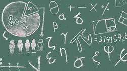Math symbols on a chalkboard