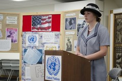 Female high school student at lectern discussing the United Nations during a Wyoming History Day event