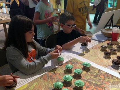 Audriana Sherlock, 8, and Smith Sherlock, 6, took core samples of cupcakes.