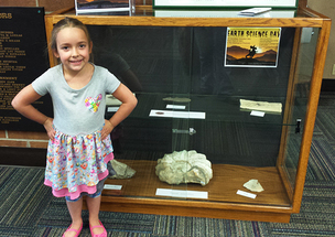 Elaina Loveland, 5, checked out several fossils at the Albany County Public Library on loan from the WSGS.