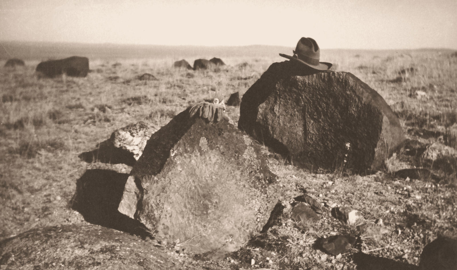 A 1,000-pound boulder of apple-green jade near Crooks Mountain. Photo taken in 1944 by Bert Rhoads; from the David J. Love Collection, WSGS files.