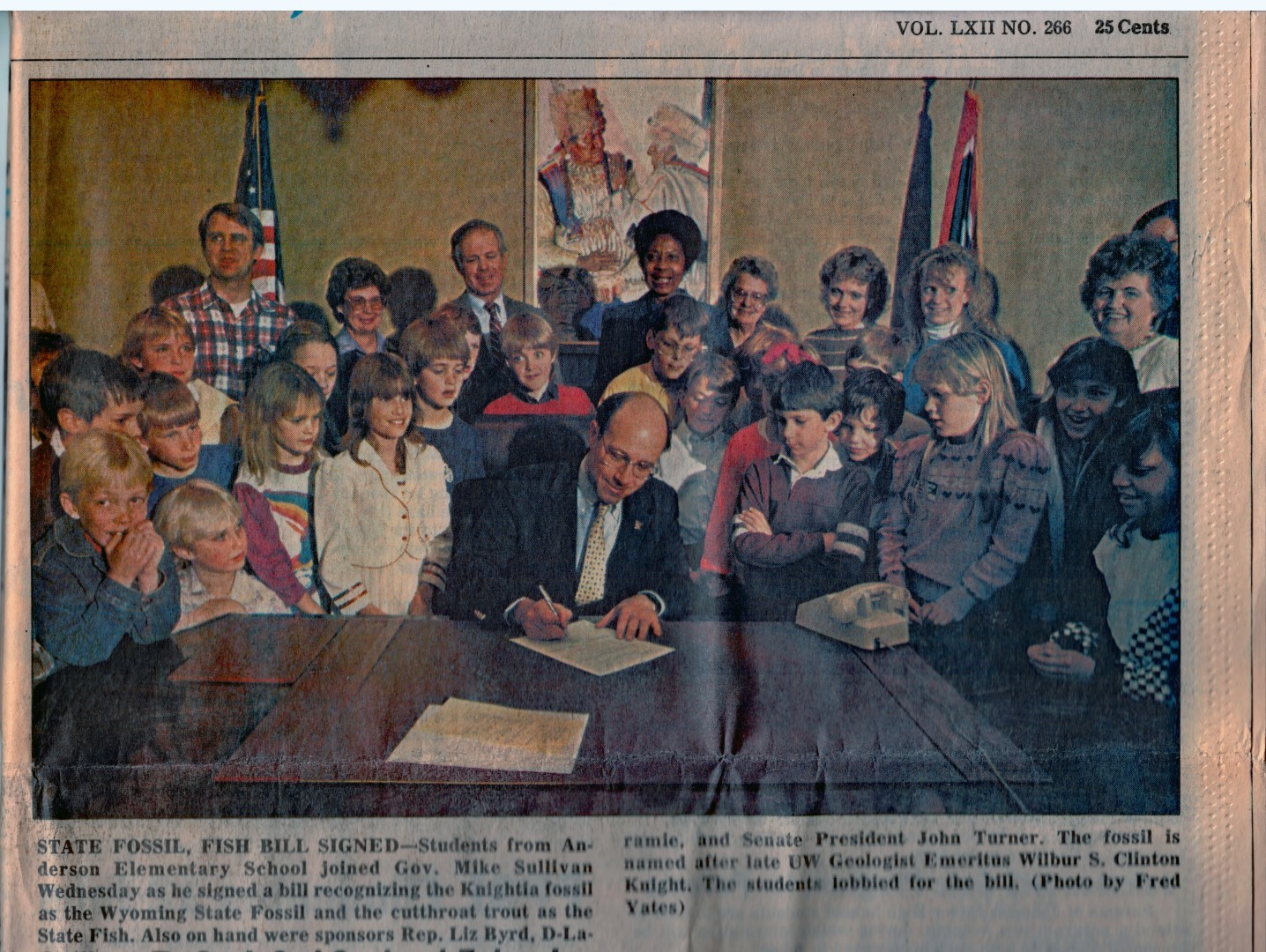 The Fossil Club watches Gov. Mike Sullivan sign a bill designating the Knightia fossil as Wyoming's State Fossil on Feb. 18, 1987.